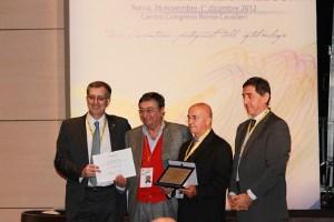 Da sinistra M. Piovella (Presidente SOI), C. M. Villani (Presidente ASMOI)...